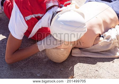 First aid training detail. Cardiopulmonary resuscitation - CPR. Paramedic in action.