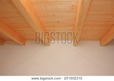 Wooden ceiling of spruce beams and decking