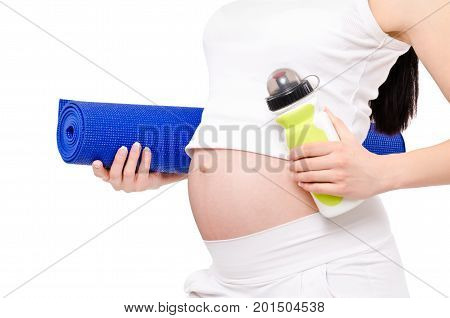 Concept of a healthy lifestyle pregnant woman. Pregnant woman standing with yoga mat and bottle of water, closeup, isolated on white background.