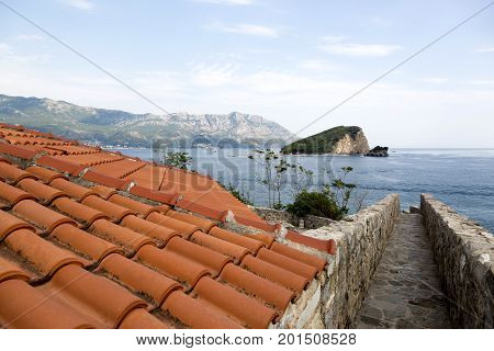 BUDVA, MONTENEGRO - AUGUST 03, 2017:View of the island of St. Nicholas from the observation deck of the ancient fortress Citadel. Budva Montenegro.