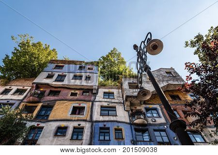 Vienna, Austria - August 15, 2017: Hundertwasserhaus in Vienna. It is is an apartment house in Vienna built after the idea and concept of Austrian artist Friedensreich Hundertwasser. It is a expressionist landmark of Vienna. Sunny day of summer