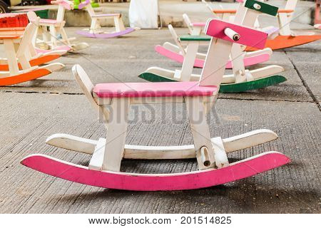 Colorful vintage rocking horse wooden chair for children could enjoy Thailand.