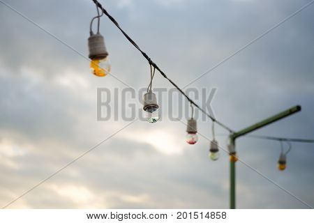 The Incandescent light bulbs in overcast sky with cloud.