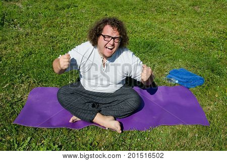 Sport, diet and a healthy lifestyle. Funny fat guy and yoga.