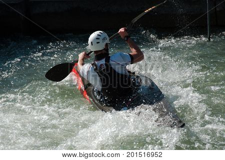 AUGSBURG, GERMANY - MARCH 28, 2017: Kayac slalom training to qualify for the Whitewater National Championships in Ottawa Canada 2017 using the course for the Summer Olympic Games in Germany in 1972.