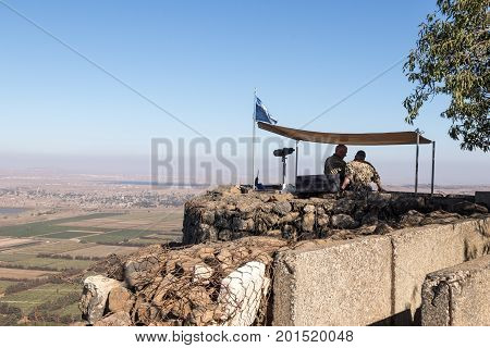 Golan Heights Israel August 27 2017 : The peacekeeper from the UN forces looks toward Syria being on a fortified point on Mount Bental on the Golan Heights in Israel.