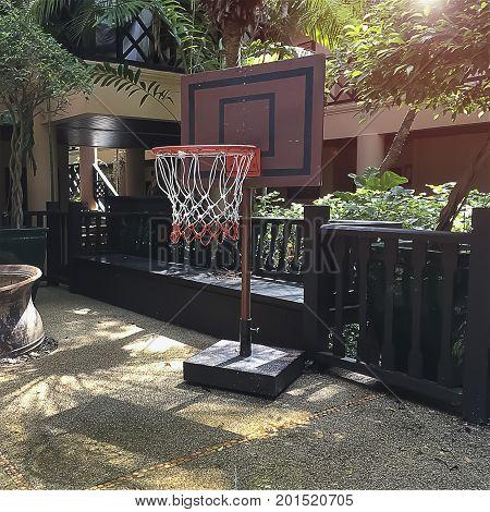 Kid's playground shown small basketball backboard pole.