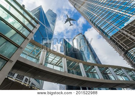 Modern office buildings in central Hong Kong with aircraft. Central Business District in Hongkong city with airplane.