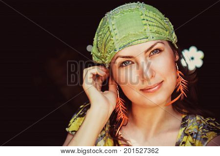 Beautiful young woman hippie posing outdoor looking at camera
