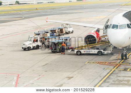 PRAGUE, CZECH REPUBLIC - JUNE 16, 2017: Vaclav Havel Prague International Airport, Ruzyne, Czech Republic. Passengers luggage loading in to the plane.