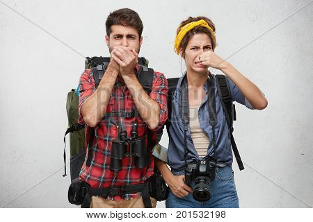 Human Facial Expressions, Emotions And Feelings. Tourism And Travel. Active Young Couple In Tourist