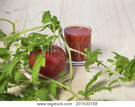 Red tomato and tomato juice tomato leaves