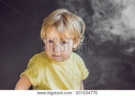 Passive Smoking Concept. The Boy Turns His Face Away From The Cigarette Smoke