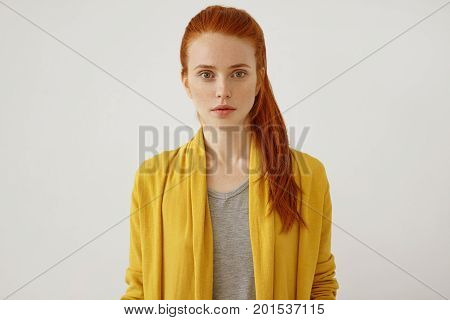 Horizontal Portrait Of Beautiful Young Female Lady With Freckles Ang Ginger Pony Tail, Wearing Yello
