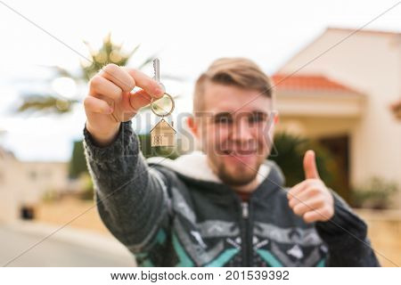 Property, ownership, new home and people concept - Young man moving into new home. poster