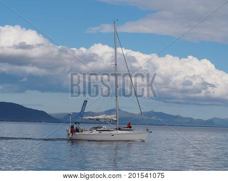 NORWAY-JULY 11, 2017. View of the fjord of the Troll in Norway. Sailing yacht. Norwegian fjord. Natural landscape. Location: Lofoten Islands, Norway. White nights morning summer travel.