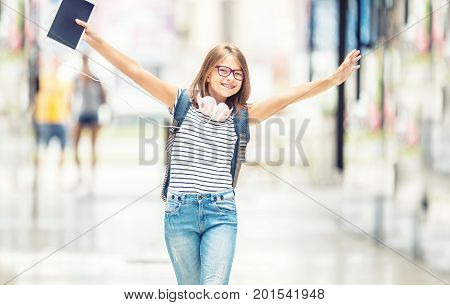 Schoolgirl With Bag, Backpack. Portrait Of Modern Happy Teen School Girl With Bag Backpack Headphone