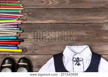 School stationery clothing school on wooden background with place for your text or advertising .Stationery. The view from the top.