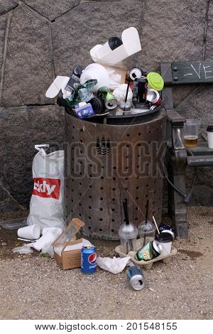 Overfull garbage can in city, Copenhagen August 26, 2017