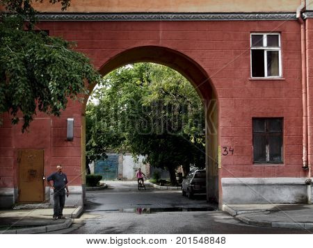 Kazakhstan, Ust-Kamenogorsk - 01, August 2017. Fragment of a building with an arch on Gogol street. Architecture. Architectural background. Antique architecture.