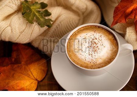 Hot Coffee And Autumn Leaves