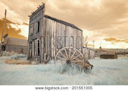 Wagon And Wooden Building In Bodie, California In Infrared