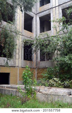 Abandoned Soviet school building construction site.Abandoned at 1991,during ukrainian undependence crisis.August 24, 2017.Near Kiev, Ukraine