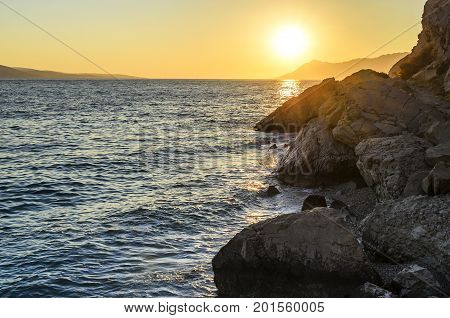 Beautiful sunset on the sea in the summer evening.