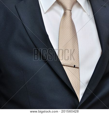 men suit perfect to the last detail. Man posing in suit