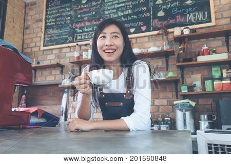 Small Business: Happy Owner Of A Cafe. Young Startup Owner Small Cafe Shop.
