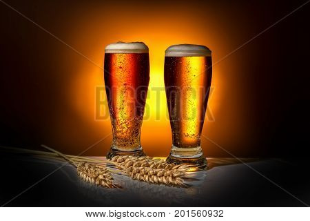 Two Dark Glass Frothy Beer With Ears Of Wheat On Light Background, Oktoberfest Concept
