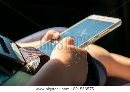 Child using mobile smart phone. Close up