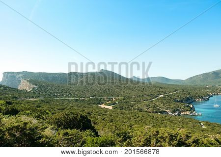 View on the Spanish Tower and the beach Mare Pintau in Sardinia, Italy.