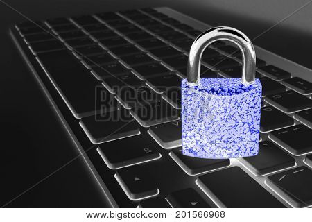 Locked computer safe from virus or malware attack. Laptop computer being protected from online cyber crime and hacking. Computer security concept with a padlock on a keyboard. protection various risks