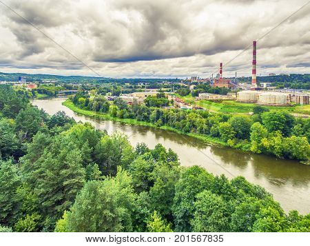 Vilnius, Lithuania: aerial UAV top view of Neris river and industrial area in Vilkpede in the summer
