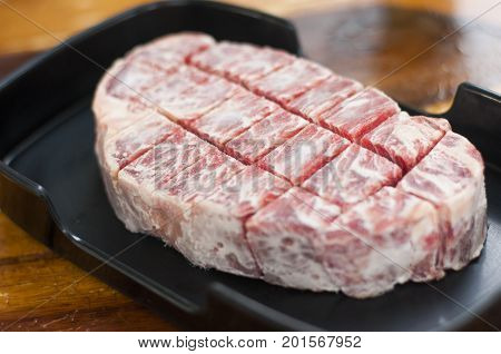 Close Up Freeze Sirloin Beef On Dish Prepare Before Grill Steak