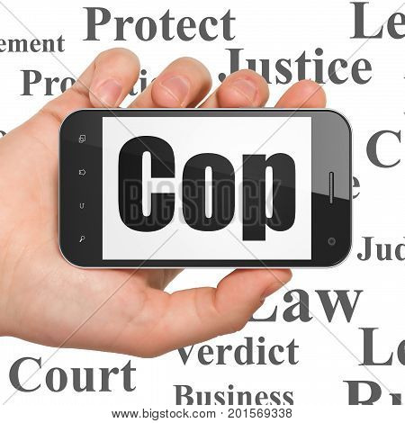 Law concept: Hand Holding Smartphone with  black text Cop on display,  Tag Cloud background, 3D rendering
