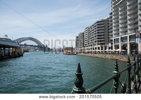 SYDNEY,NSW,AUSTRALIA-NOVEMBER 20,2016: Circular Quay with ferry, terminal, cruise ship, high-rise apartments, tourists and the Sydney Harbour Bridge in Sydney, Australia