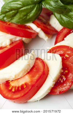 mozarella basil and tomatoes on white background