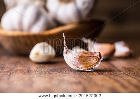 Garlic. Garlic Cloves And Garlic Bulb In Vintage Wooden Bowl