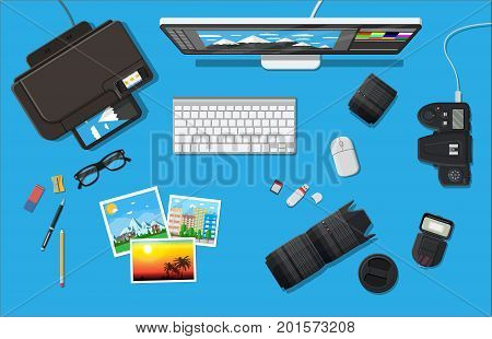 Workspace of photographer. Desktop pc, printer. Modern photo camera, flash, lens and memory card. Professional device for photography. Digital photos and printing. Vector illustration in flat style