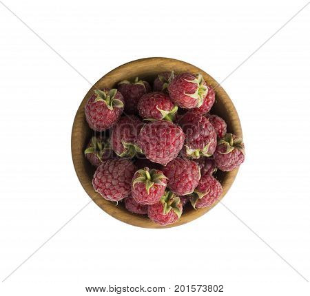 Raspberries in a wooden bowl isolated on white background. Raspberry close-up. Vegetarian or healthy eating. Juicy and delicious raspberries