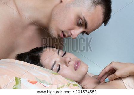 The Guy Tries To Wake The Girl With A Kiss. Morning Awakening