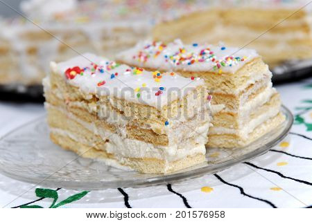 Delicious sponge cake with cream. Home-baked cake.