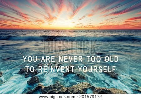 Inspirational Quote - You Are Never Too Old To Reinvent Yourself. Retro Styled Blurry Background.