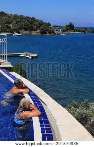 28TH JULY 2017, TURKEY:Two english ladies relaxing in an infinity pool while on vacation in turkey , 28th july 2017
