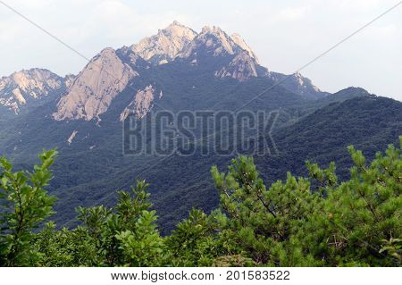 Baegundae peak of Bukhansan Mountain in Bukhansan National Park, is a popular peak to climb, though is steep and exposed with chains and cables to help climbers, Seoul Korea