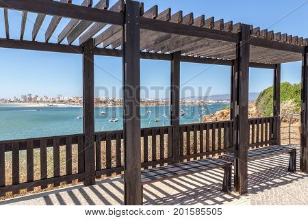 Arbor for shade, on the beach of the city of Portimao. Portugal