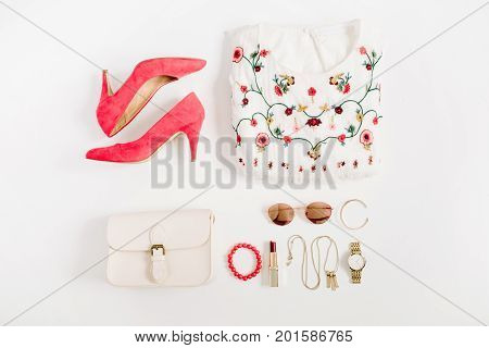 Woman styled fashion clothes and accessories collage on white background. Flat lay top view.