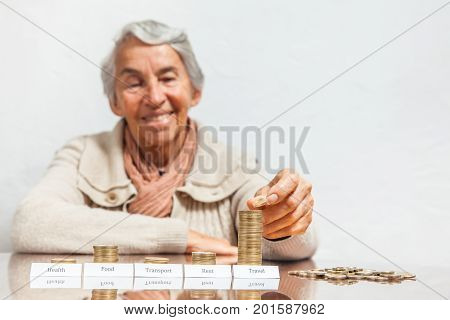 Senior Woman Budget With Big Savings For Travel